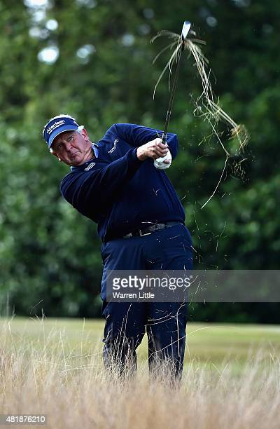 Colin Montgomerie of Scotland plays out of the rough on the 17th hole during completion of the second round of The Senior Open Championship on the...