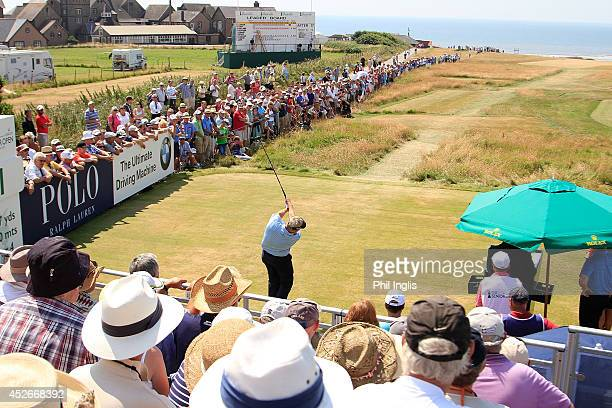 Colin Montgomerie of Scotland plays the 1st hole during the second round of the Senior Open Championship played at Royal Porthcawl Golf Club on July...