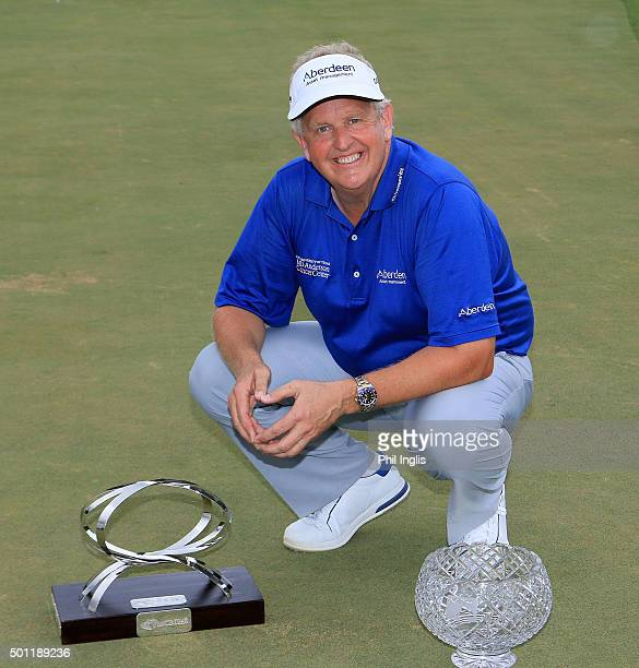 Colin Montgomerie of Scotland poses with the MCB trophy and the John Jacobs trophy for winning the Order of Merit 2015 after the final round of the...