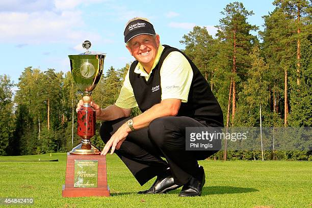 Colin Montgomerie of Scotland poses with the trophy after the final round of the Russian Open Golf Championship played at Moscow Country Club and...