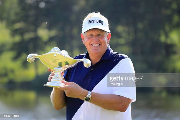 Colin Montgomerie of Scotland poses with the trophy on Day Three of The Shipco Masters Promoted by Simons Golf Club at Simon's Golf Club on June 3...