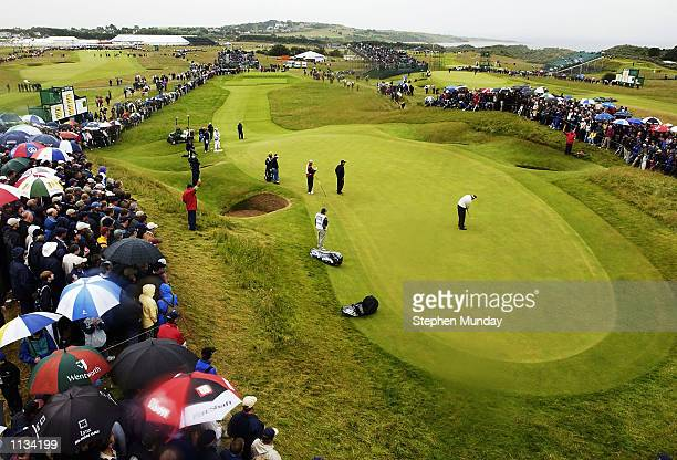 Colin Montgomerie of Scotland putts on the 13th green during the second round of the 131st Open Championships at Muirfield Golf Club Gullane Scotland...