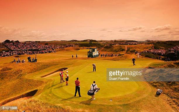 Colin Montgomerie of Scotland putts on the 8th hole 'The Postage Stamp' during the first round of the 133rd Open Championship at the Royal Troon Golf...