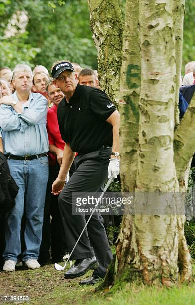 Colin Montgomerie of Scotland reacts to his second shot on the 17th hole during the Second Round of the HSBC World Matchplay Championship at The...