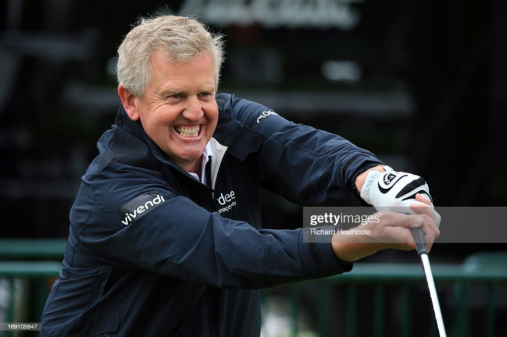 Colin Montgomerie of Scotland shares a joke on the driving range during a practise day for the BMW PGA Championships at Wentworth on May 20, 2013 in Virginia Water, England.