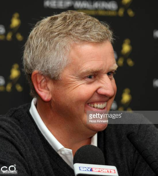 Colin Montgomerie of Scotland talks during his press conference before the pro-am event prior to the Johnnie Walker Championship on the PGA Centenary...
