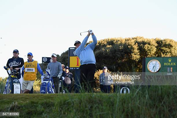 Colin Montgomerie of Scotland tees off on the 1st hole during the first round on day one of the 145th Open Championship at Royal Troon on July 14...