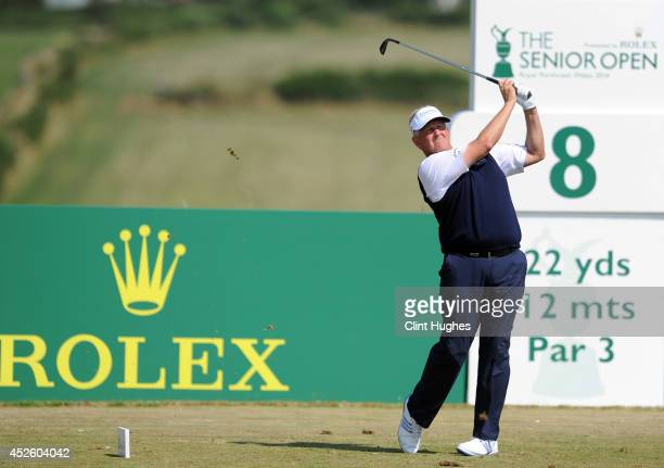 Colin Montgomerie of Scotland tees off on the 8th hole during the first round of the Senior Open Championship at Royal Porthcawl Golf Club on July 24...