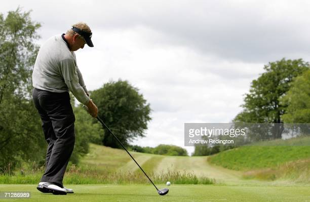 Colin Montgomerie of Scotland tees off on the fifth hole during the third round of The Johnnie Walker Championship on The PGA Centenary Course at...