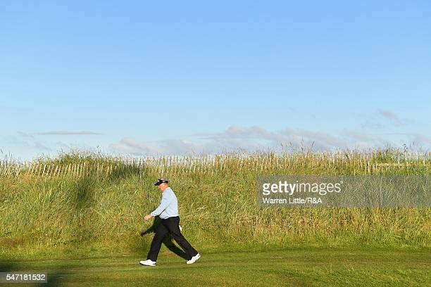 Colin Montgomerie of Scotland walks down the 1st hole during the first round on day one of the 145th Open Championship at Royal Troon on July 14 2016...