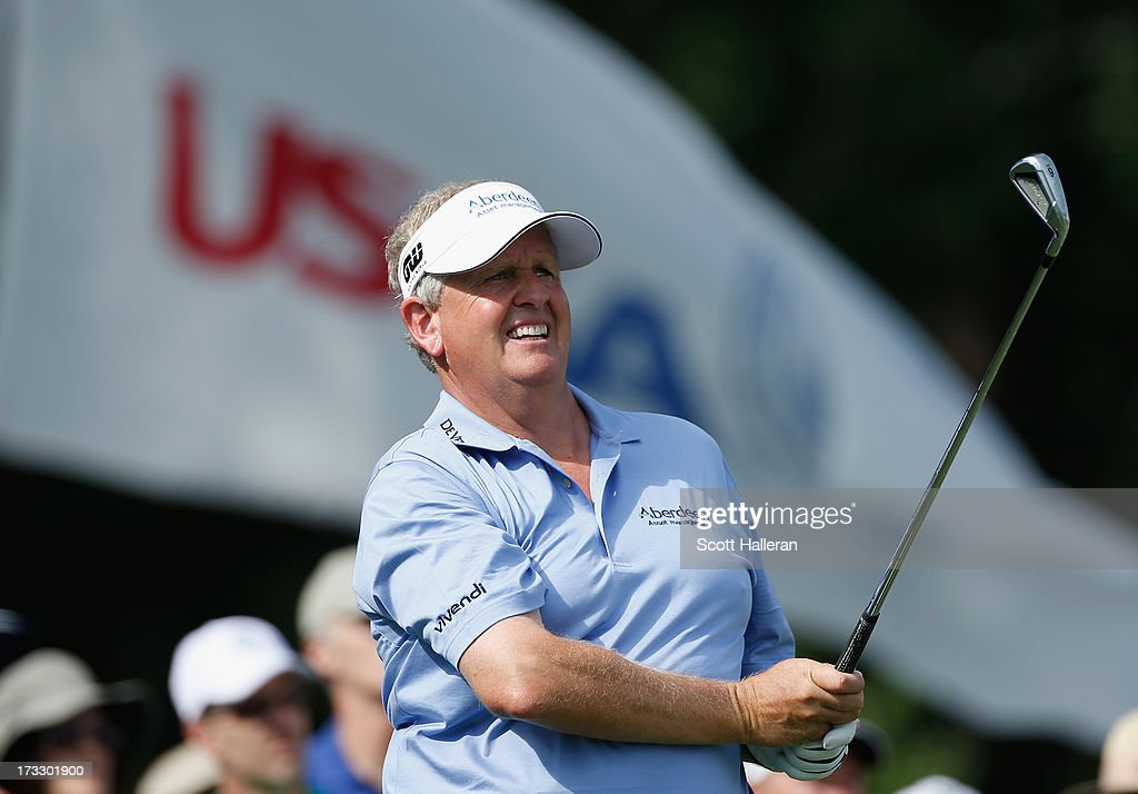 Colin Montgomerie of Scotland watches his tee shot on the 16th hole during the first round of the 2013 U.S. Senior Open Championship at Omaha Coutry Club on July 11, 2013 in Omaha, Nebraska.
