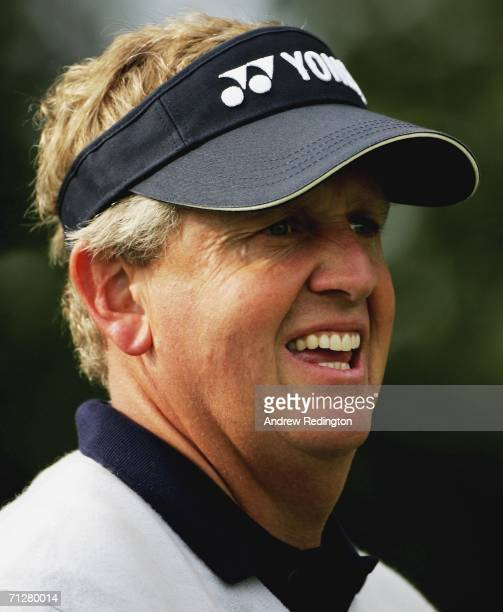 Colin Montgomerie of Scotland watches his tee-shot on the 11th hole during the second round of The Johnnie Walker Championship on The PGA Centenary...