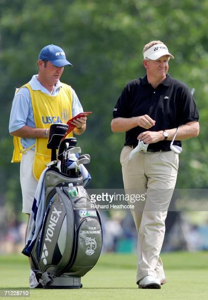 Colin Montgomerie of Scotland with his caddie Alastair Matheson on the second hole during the third round of the 2006 US Open Championship at Winged...