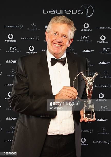 """Colin Montgomerie poses with the award for """"Laureus Spirit Of Sport Award"""" to the European Ryder Cup team in the winners studio at the 2011 Laureus..."""