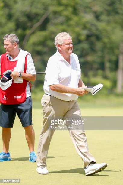 Colin Montgomerie walks on to the eighteenth green during the final round of the American Family Insurance Championship Champions Tour golf...