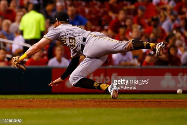 Colin Moran of the Pittsburgh Pirates attempts to field a line drive against the St Louis Cardinals in the fifth inning at Busch Stadium on August 28...