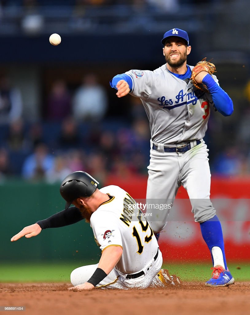 Colin Moran #19 of the Pittsburgh Pirates breaks up a double play attempt by Chris Taylor #3 of the Los Angeles Dodgers during the third inning at PNC Park on June 6, 2018 in Pittsburgh, Pennsylvania.