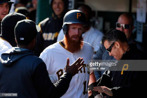 Colin Moran of the Pittsburgh Pirates celebrates after hitting a solo home run in the eighth inning against the St. Louis Cardinals at the home...
