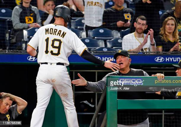 Colin Moran of the Pittsburgh Pirates celebrates with manager Clint Hurdle after scoring on an RBI single in the third inning against the Arizona...