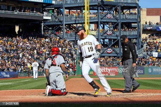 Colin Moran of the Pittsburgh Pirates crosses the plate after hitting a solo home run in the eighth inning against the St. Louis Cardinals at the...