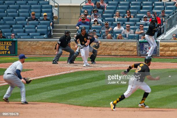 Colin Moran of the Pittsburgh Pirates grounds into a fielder's choice in the sixth inning during game one of a doubleheader against the Milwaukee...