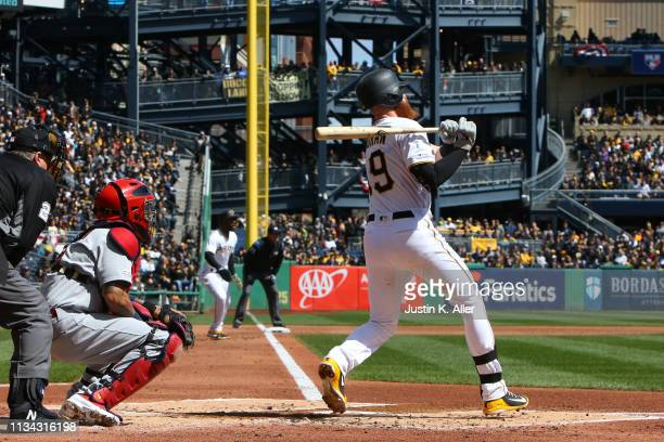 Colin Moran of the Pittsburgh Pirates hits a two RBI double in the first inning against the St. Louis Cardinals at the home opener at PNC Park on...