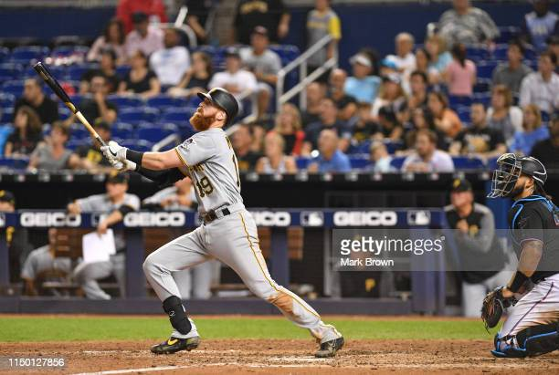 Colin Moran of the Pittsburgh Pirates hits a two run homerun in the seventh inning against the Miami Marlins at Marlins Park on June 14 2019 in Miami...