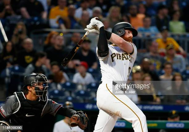 Colin Moran of the Pittsburgh Pirates hits an RBI double in the third inning against the Arizona Diamondbacks at PNC Park on April 22 2019 in...