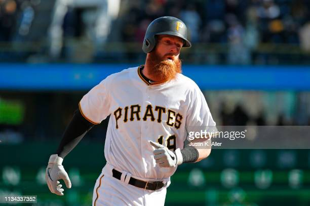 Colin Moran of the Pittsburgh Pirates rounds second after hitting a solo home run in the eighth inning against the St. Louis Cardinals at the home...