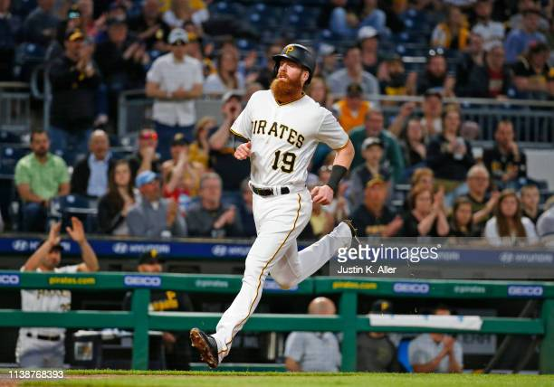 Colin Moran of the Pittsburgh Pirates scores on an RBI single in the third inning against the Arizona Diamondbacks at PNC Park on April 22 2019 in...