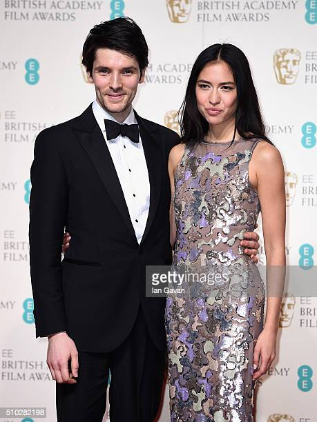 Colin Morgan and Sonoya Mizuno pose in the winners room at the EE British Academy Film Awards at the Royal Opera House on February 14 2016 in London...