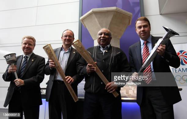 Colin Moynihan Paul Mears Jim Redmond and Andy Hunt pose for a photograph in front of the London 1948 Olympic Cauldron as The BOA announce the...