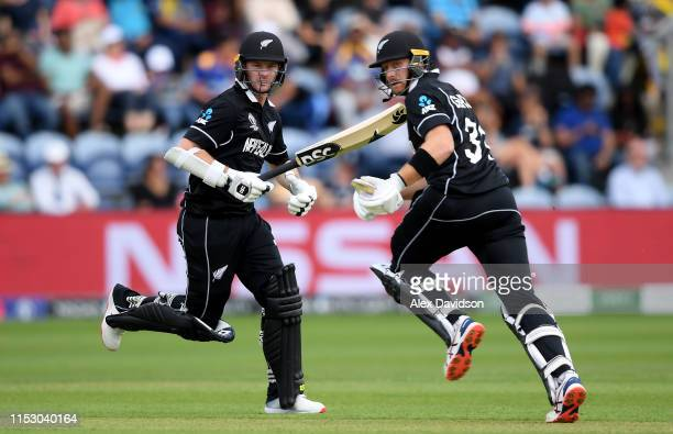 Colin Munro and Martin Guptill of New Zealand take a run during the Group Stage match of the ICC Cricket World Cup 2019 between New Zealand and Sri...