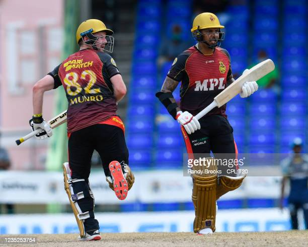 Colin Munro and Sunil Narine of Trinbago Knight Riders 50 runs partnership during the 2021 Hero Caribbean Premier League Play-Off match 31 between...