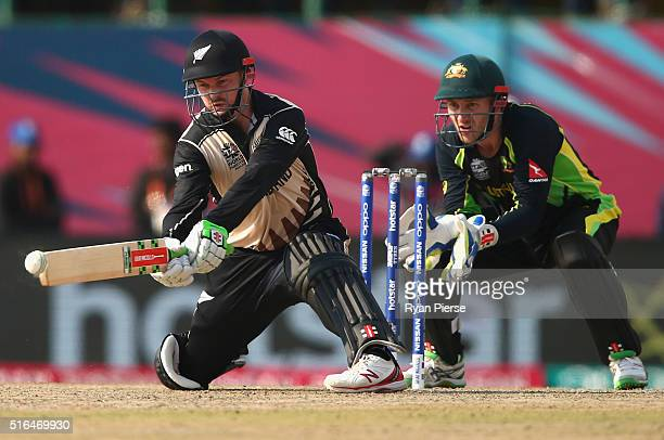 Colin Munro of New Zealand bats as Peter Nevill of Australia keeps wickets during the ICC World Twenty20 India 2016 Super 10s Group 2 match between...