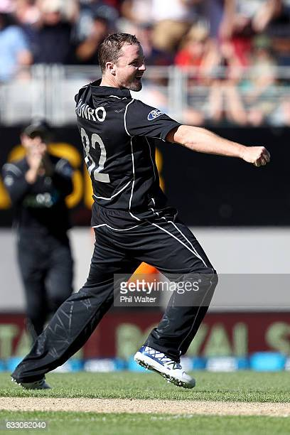 Colin Munro of New Zealand celebrates his dismissal off James Faulkner of Australia during the first One Day International game between New Zealand...