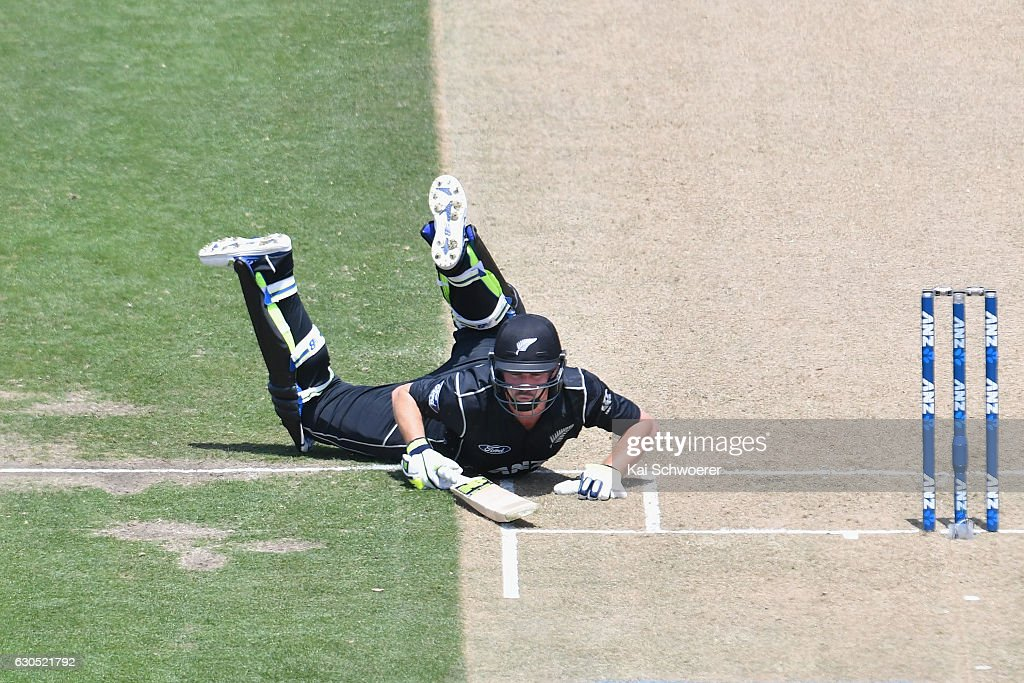 Colin Munro of New Zealand dives to save his wicket during the first One Day International match between New Zealand and Bangladesh at Hagley Oval on December 26, 2016 in Christchurch, New Zealand.