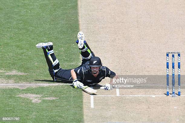 Colin Munro of New Zealand dives to save his wicket during the first One Day International match between New Zealand and Bangladesh at Hagley Oval on...