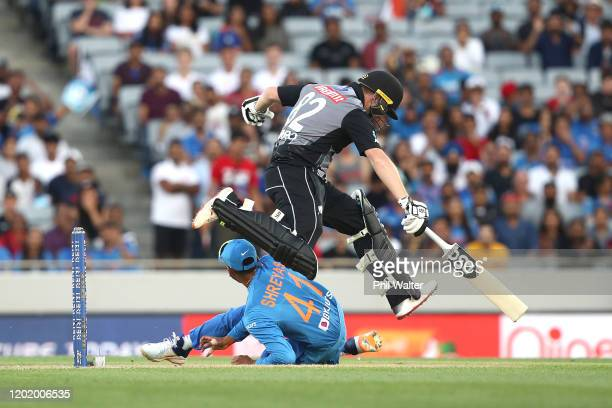 Colin Munro of New Zealand leaps over Shreyas Iyer of India during game two of the Twenty20 series between New Zealand and India at Eden Park on...