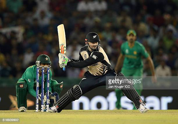 Colin Munro of New Zealand plays a reverse sweep with Sarfraz Ahmed of Pakistan looking on during the ICC World Twenty20 India 2016 Super 10s Group 2...