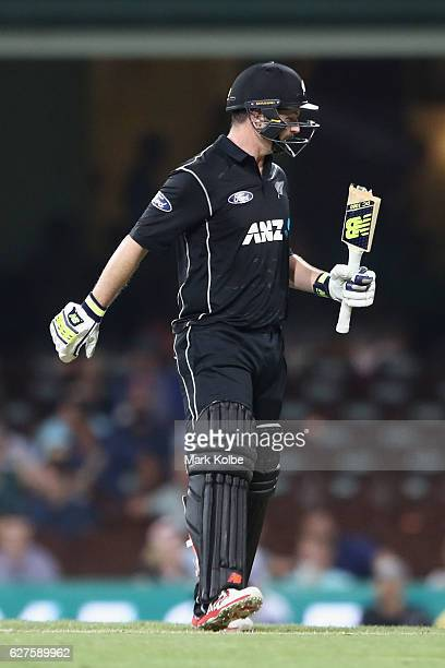 Colin Munro of New Zealand reacts after breaking his bat during game one of the One Day International series between Australia and New Zealand at...