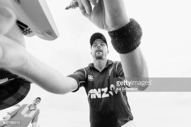 Colin Munro of New Zealand signs autographs during the second match in the One Day International series between New Zealand and Pakistan at Saxton...