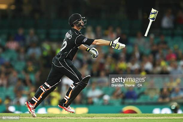 Colin Munro of New Zealand throws his broken bat handle during game one of the One Day International series between Australia and New Zealand at...