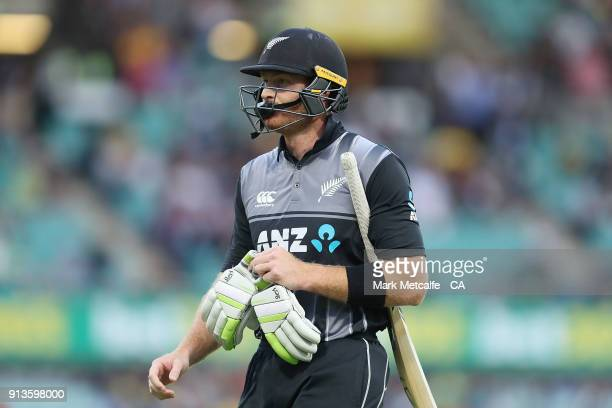 Colin Munro of New Zealand walks from the field after being dismissed by Billy Stanlake of Australia during game one of the International Twenty20...