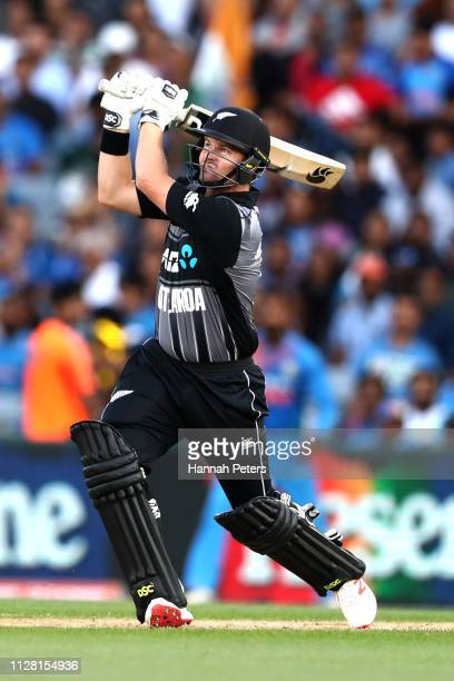 Colin Munro of the Black Caps hits the ball away for six runs during game two of the International T20 Series between the New Zealand Black Caps and...