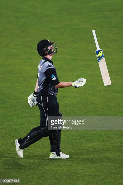 Colin Munro of the Black Caps walks off after being dismissed by Mohammad Amir of Pakistan during the International Twenty20 match between New...