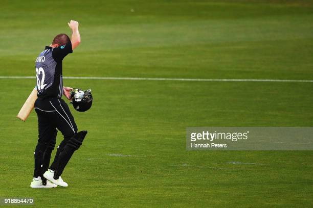 Colin Munro of the Black Caps walks off after being dismissed by Andrew Tye of Australia during the International Twenty20 match between New Zealand...