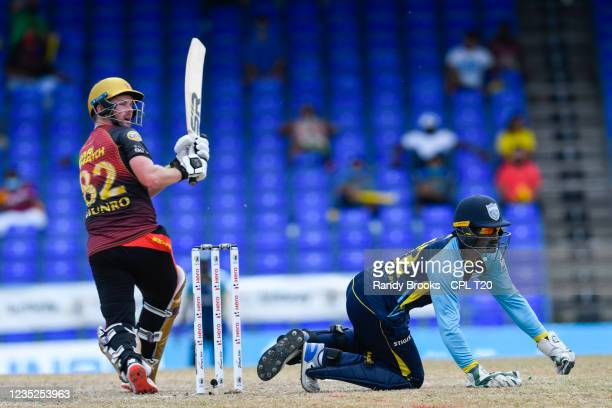 Colin Munro of Trinbago Knight Riders hits pass Andre Fletcher of Saint Lucia Kings during the 2021 Hero Caribbean Premier League Play-Off match 31...