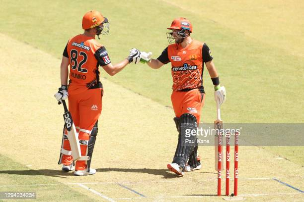 Colin Munroand Josh Inglisof the Scorchers celebrate a six during the Big Bash League match between the Perth Scorchers and the Melbourne Renegades...