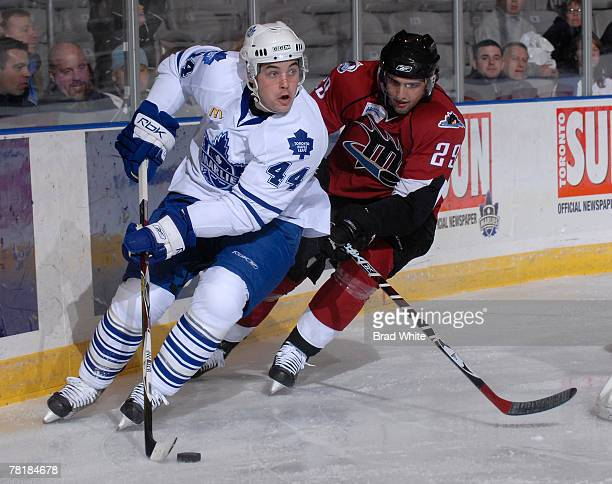 Colin Murphy of the Toronto Marlies battles for the puck with Wes O'Neill of the Lake Erie Monsters November 30 2007 at the Ricoh Coliseum in Toronto...